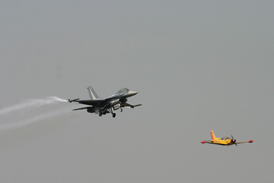 Belgian F-16 and Marchettif SF-206 in formation