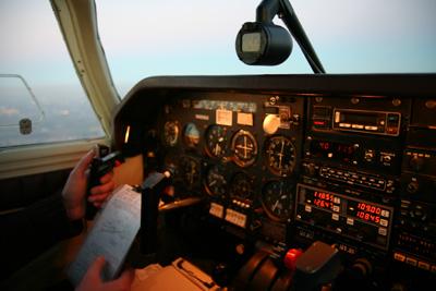 Cockpit lights coming on at dusk