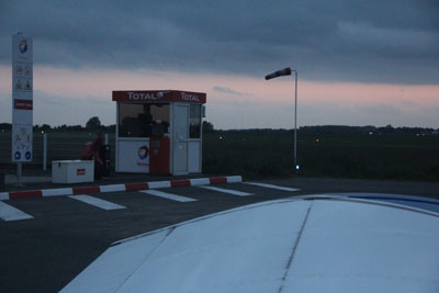 At the fuel pump in Lille at dusk