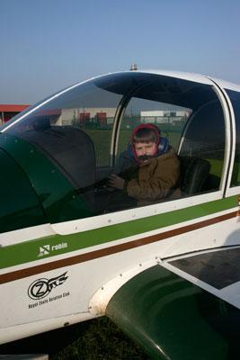 Son posing at aircraft