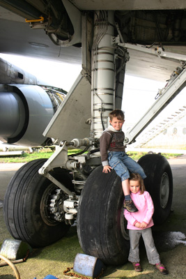 Kids on 747 undercarriage